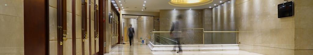 Figures walking through an office hallway